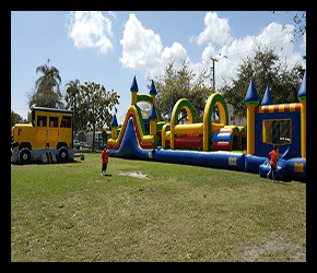 Water slide rentals Miami with obstacle courses