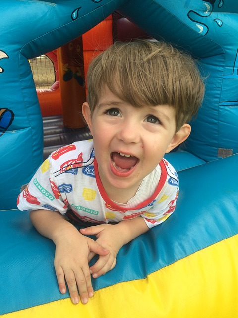 Boy playing inside a bounce house