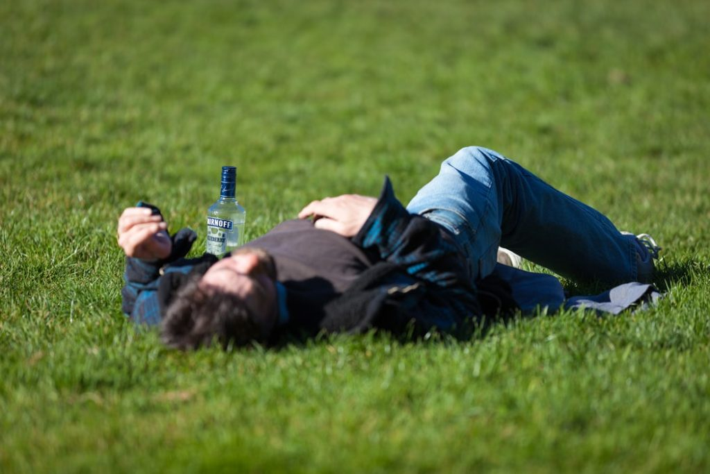 drunk person on the lawn