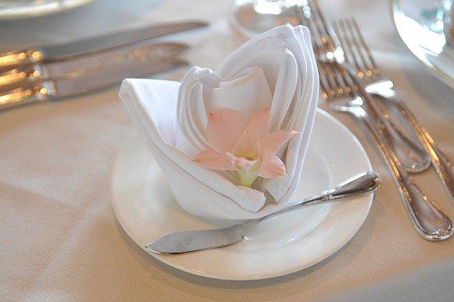 wedding napkin folded with a flower